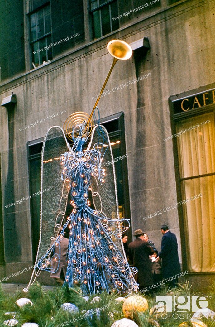 Stock Photo: View of a wire sculpture Christmas angel decoration located in the Channel Gardens promenade of Rockefeller Center Plaza, midtown Manhattan, New York City.