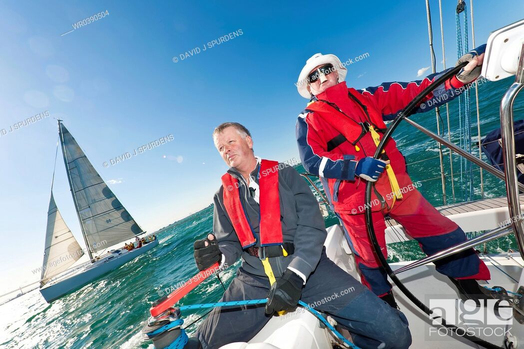 Stock Photo: The captain steers the yacht in an offshore yacht race.