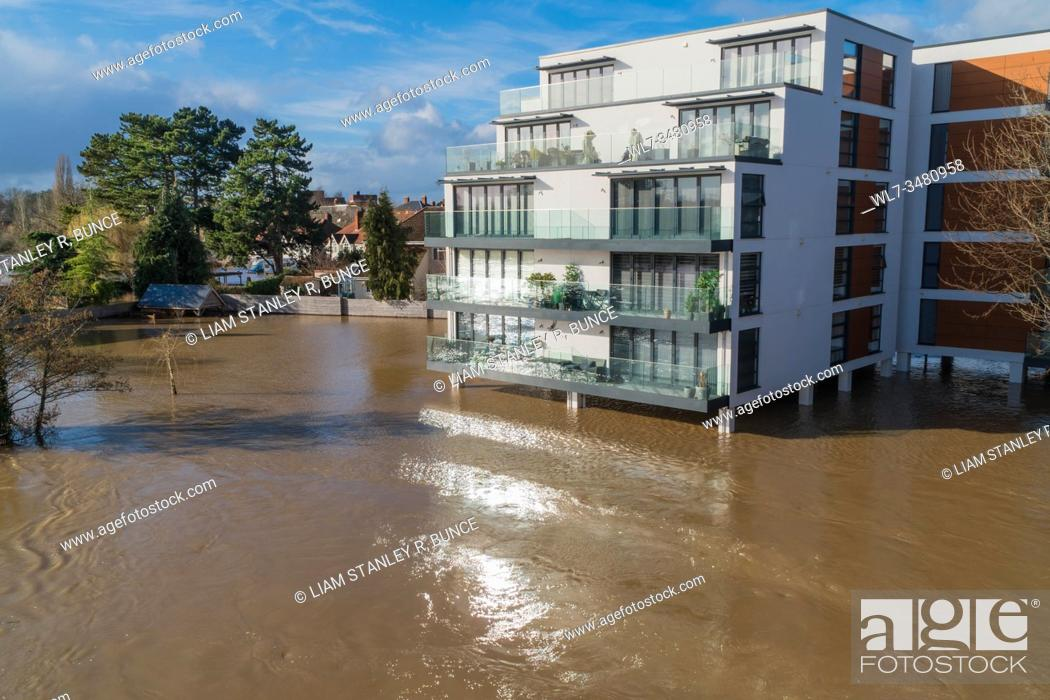 Stock Photo: Fryers Gate apartments under a deluge of flood water as the highest levels on the river Wye are recorded in Hereford, Herefordshire UK. February 2020.