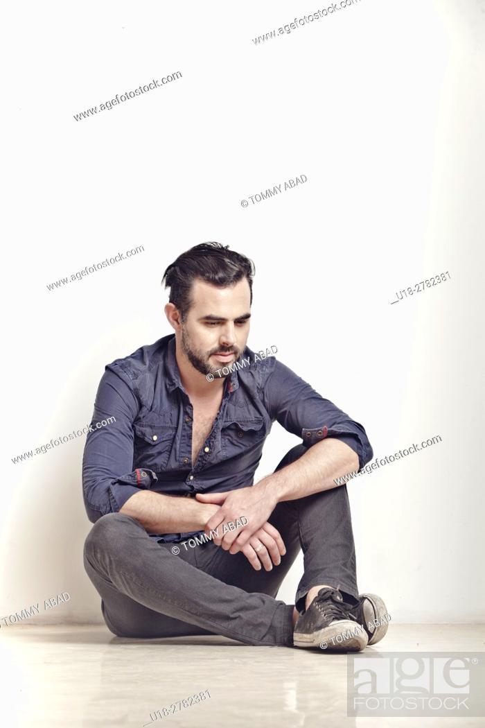 Stock Photo: Man sitting on the floor thinking.