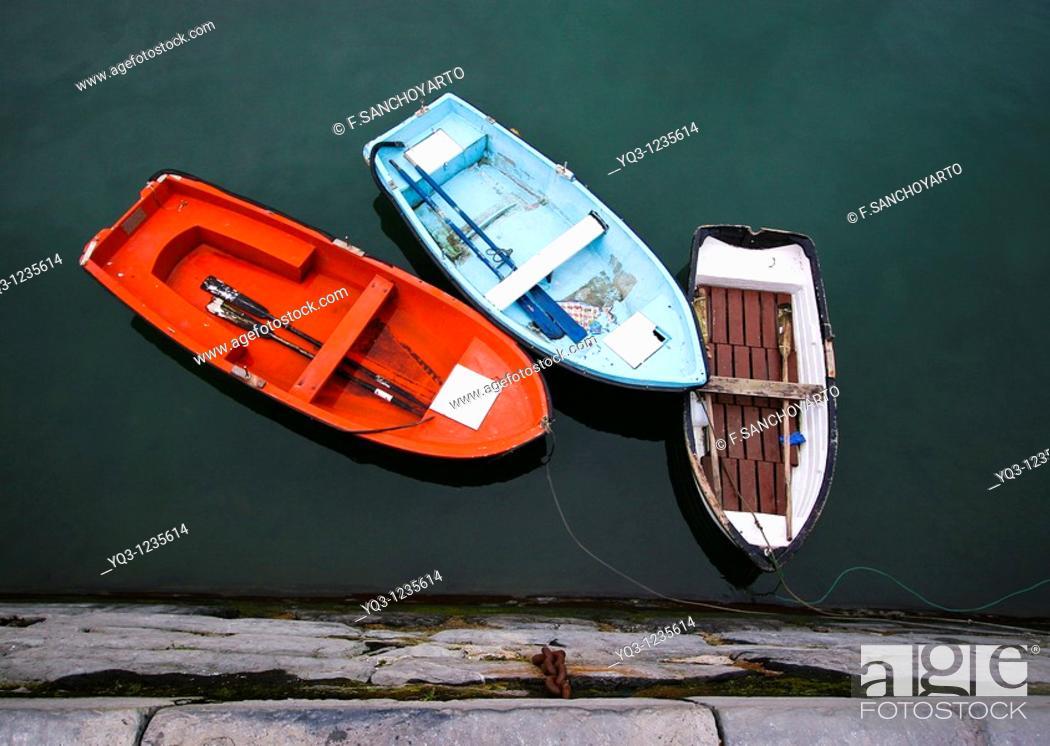Stock Photo: Auxiliar boatsalongside dock. Port of Castro Urdiales , Cantabria, Spain.
