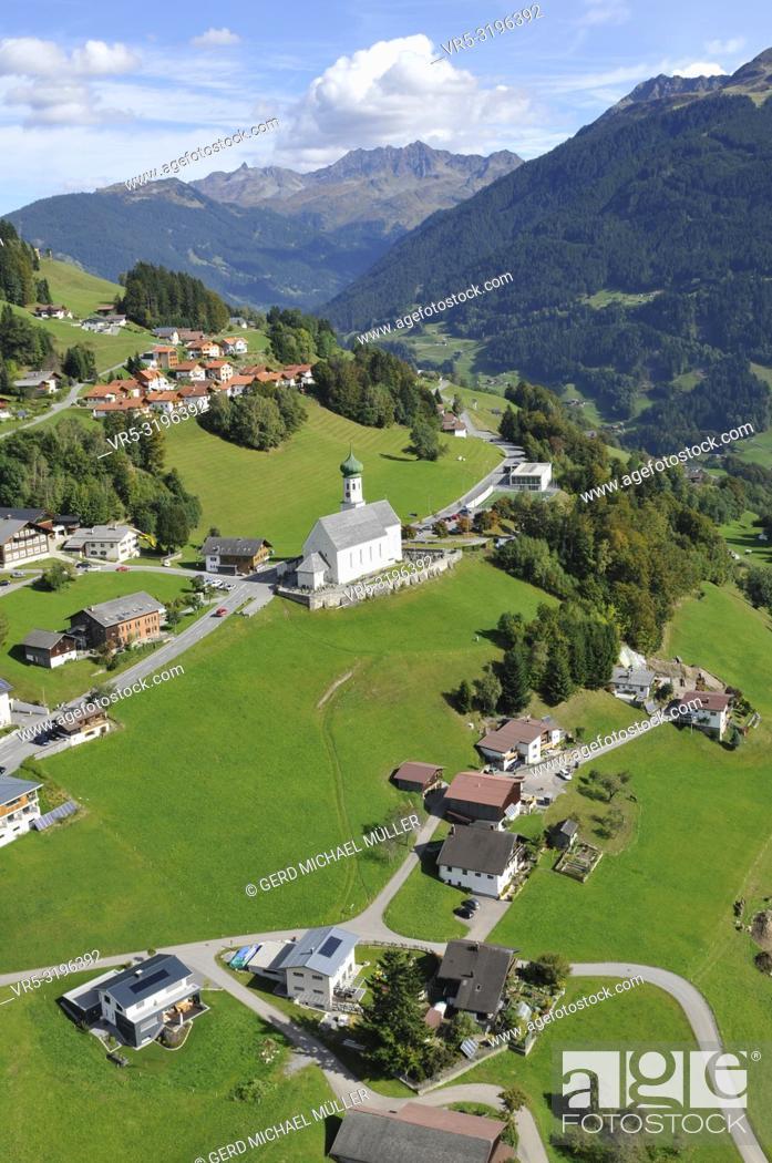 Stock Photo: Austria: Airshot of the Barholomäus church above Schruns while paragliding in the Montafon valley, Vorarlberg, .