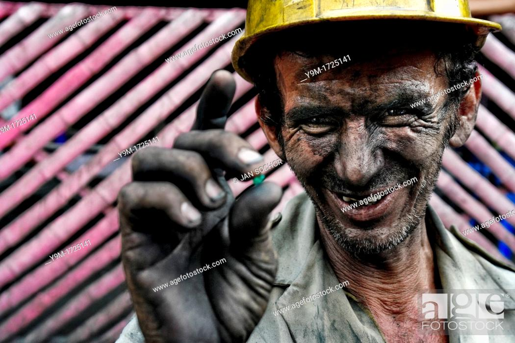 Stock Photo: A miner shows a rough emerald found in the mine of Muzo, Colombia, 21 April 2006  Despite of a persisting civil war conflict and related difficulties Colombia.