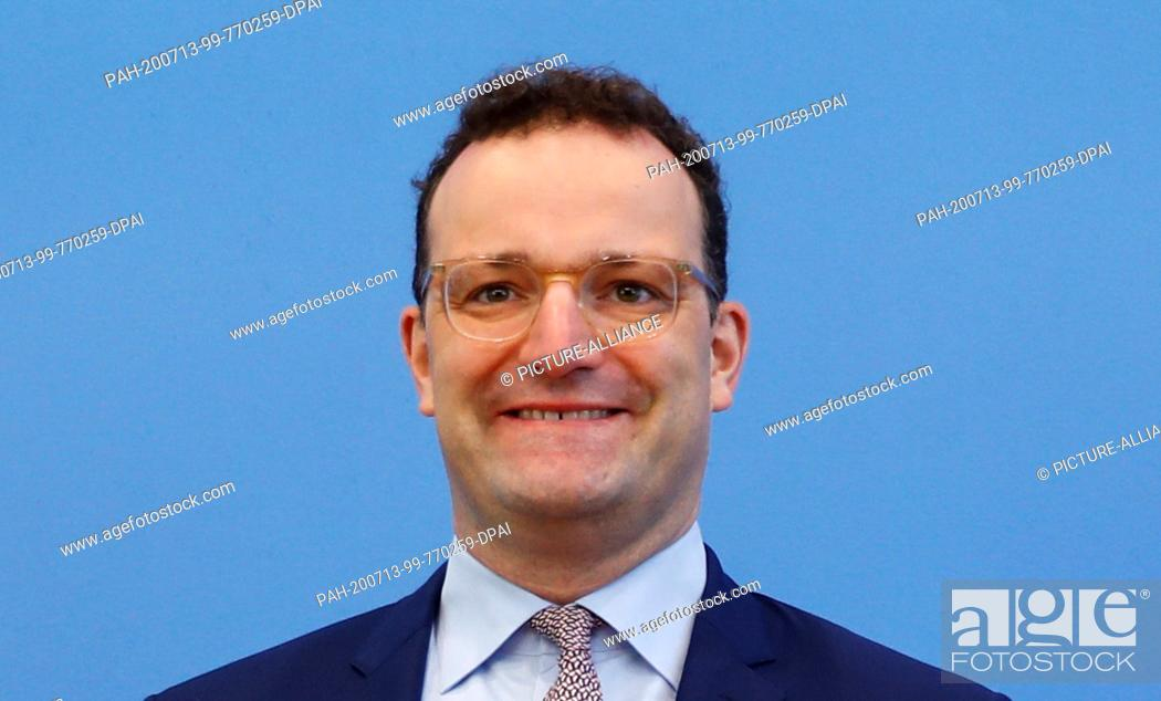 Stock Photo: 13 July 2020, Berlin: Jens Spahn (CDU), Minister of Health, is sitting at a joint press conference with the President of the Robert Koch Institute (RKI).