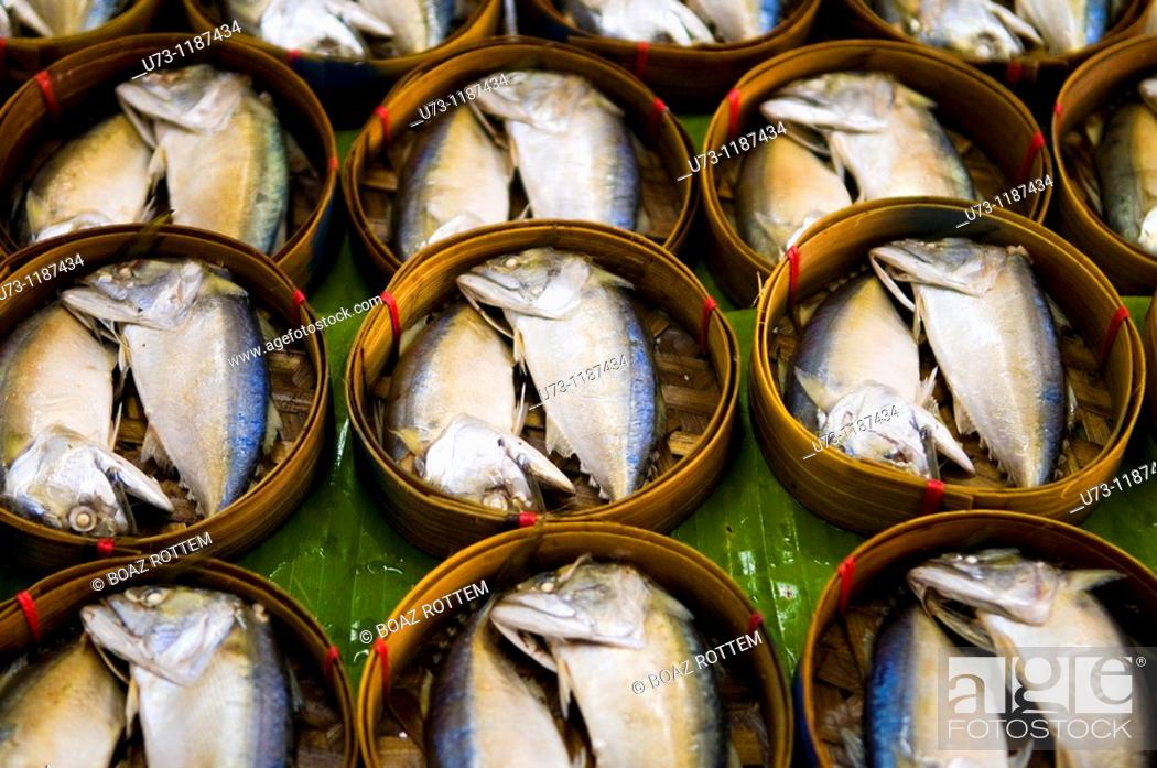Stock Photo: Steamed fish for breakfast sold in a colorful market in downtown Bangkok.