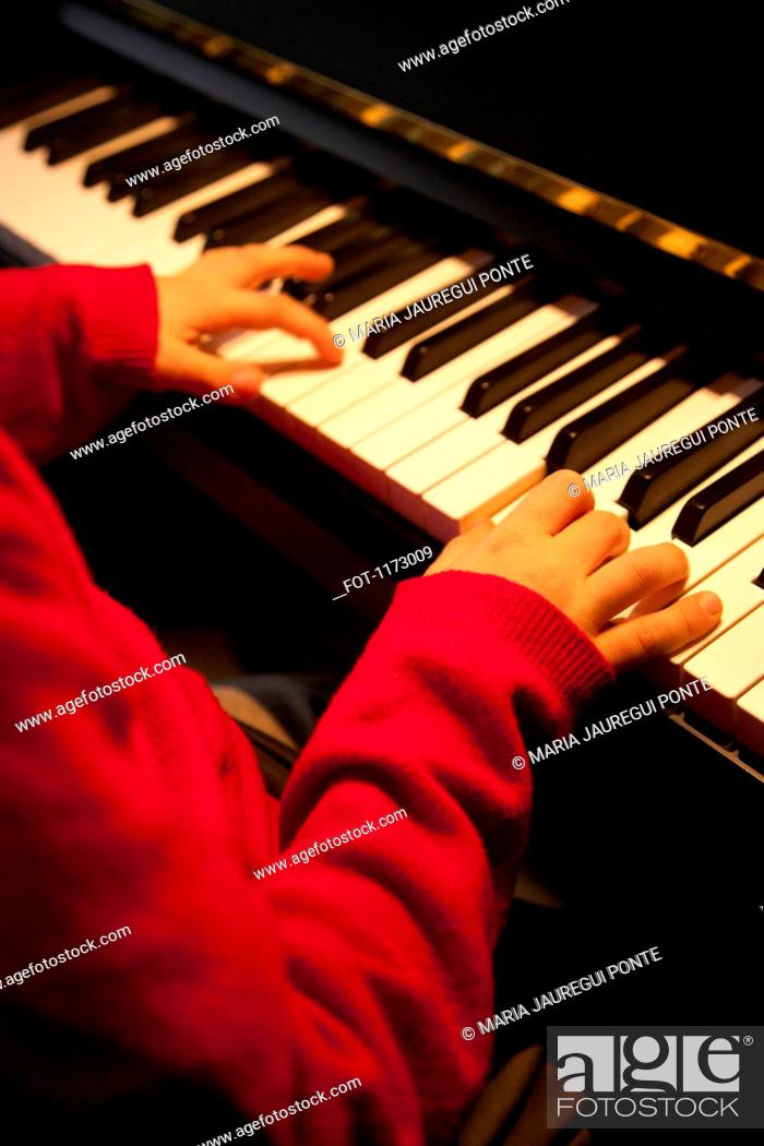 Photo de stock: Child piano player.