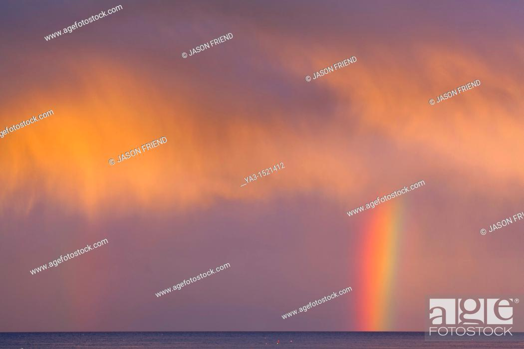 Stock Photo: Scotland, Scottish Borders, Burnmouth  Rainbow above the north sea, photographed just before sunset.