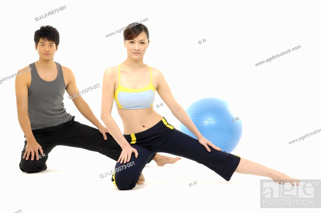 Stock Photo: Group of people doing stretching yoga exercise.