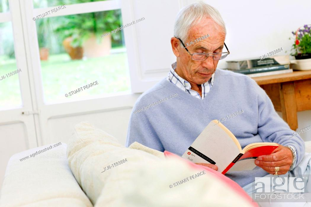 Stock Photo: Senior man reading book.