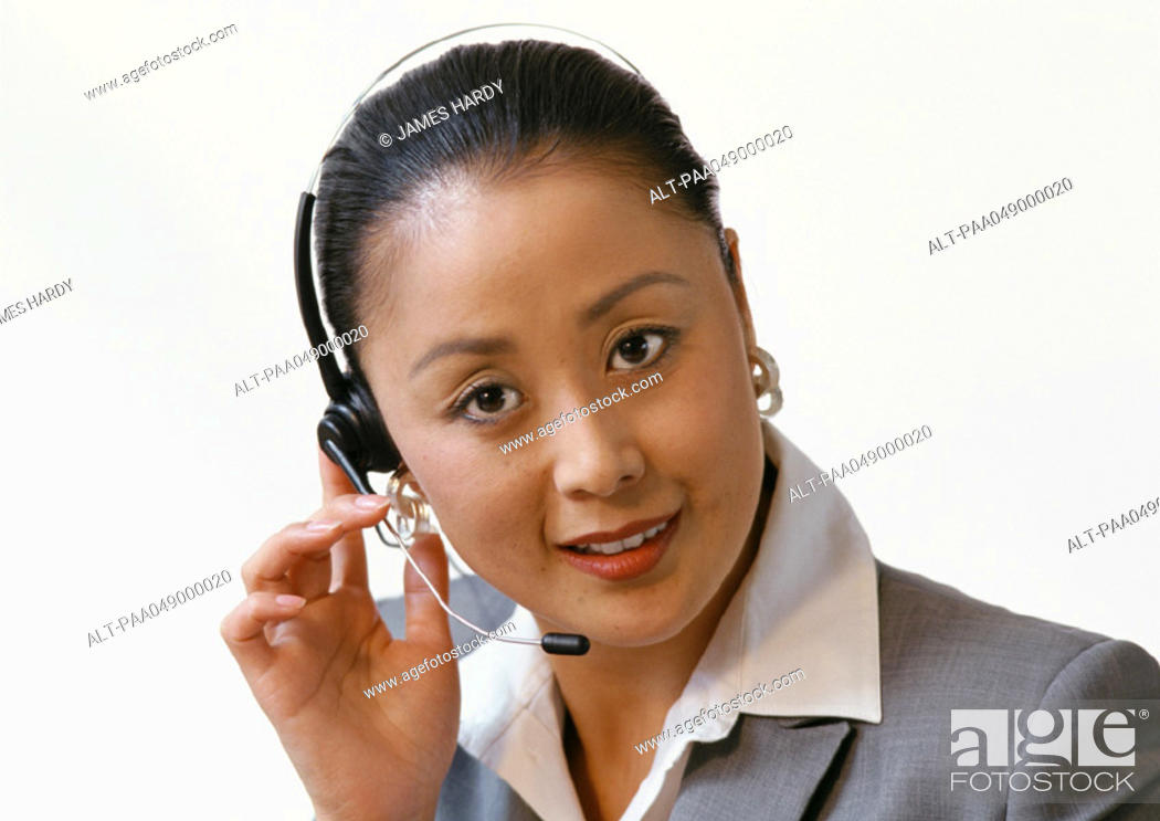 Stock Photo: Woman wearing headset, portrait.