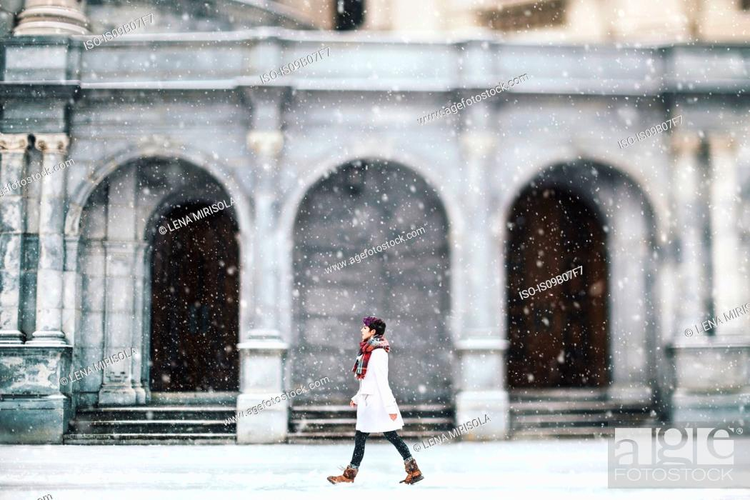 Stock Photo: Young woman in front of the Christian Science Centre, Boston, Massachusetts, USA.