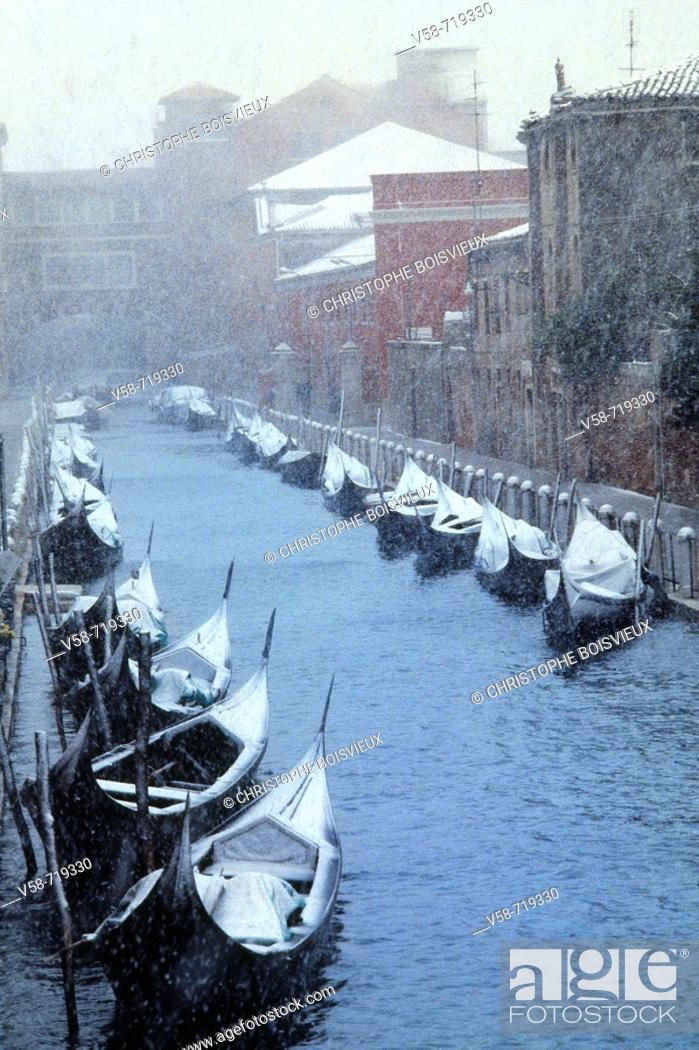Stock Photo: Snowstorm and gondolas. Venice. Italy.