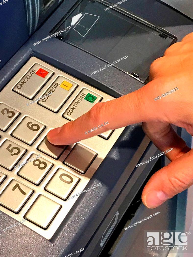 Photo de stock: Hand typing secret code in the ATM.