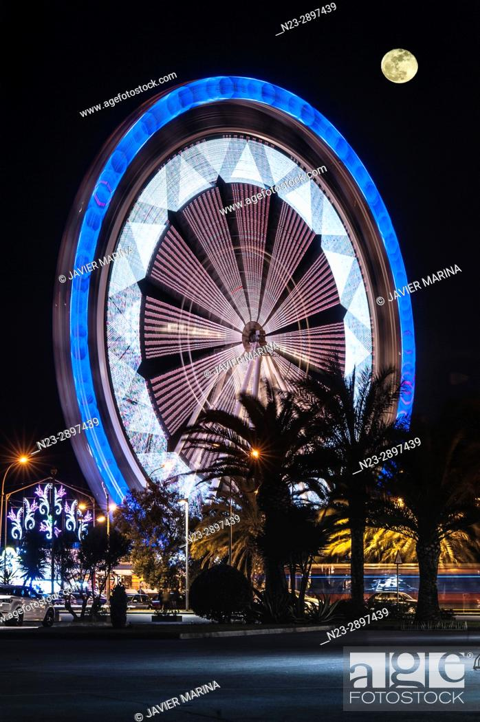 Stock Photo: Ferris wheel and moon at the fair in Valencia, Valencian Community, Spain.