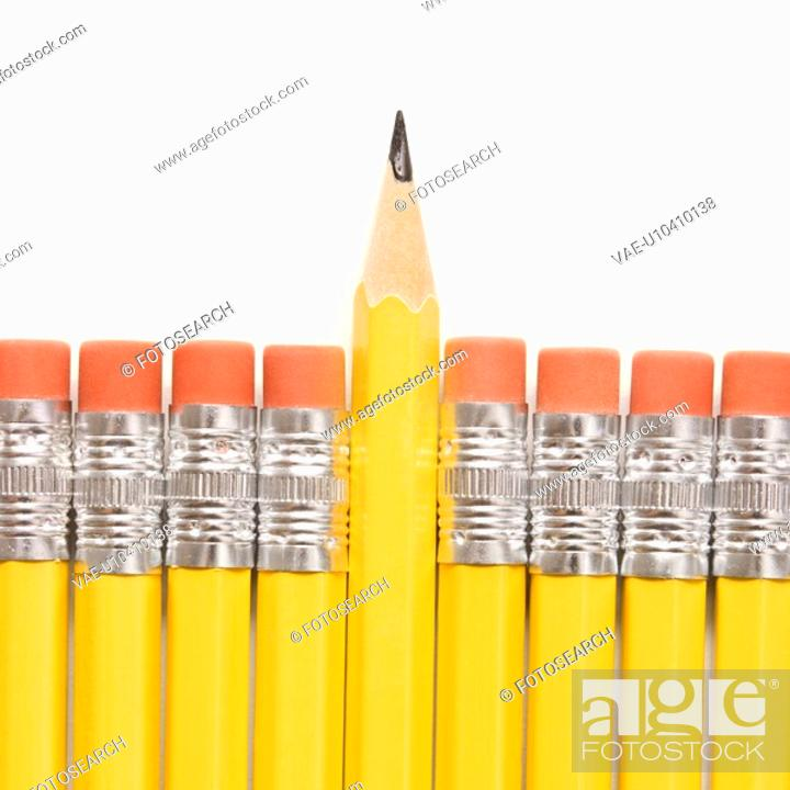 Stock Photo: Sharp pencil raised above row of pencils with eraser ends up.