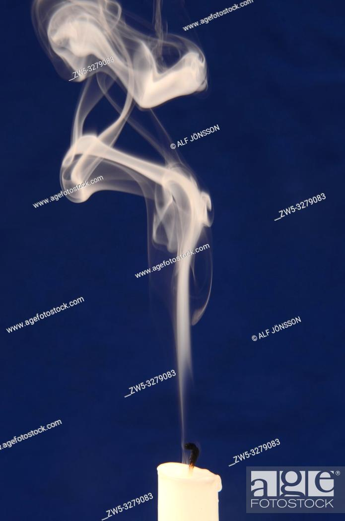 Stock Photo: Smoke from a blown-out candle.
