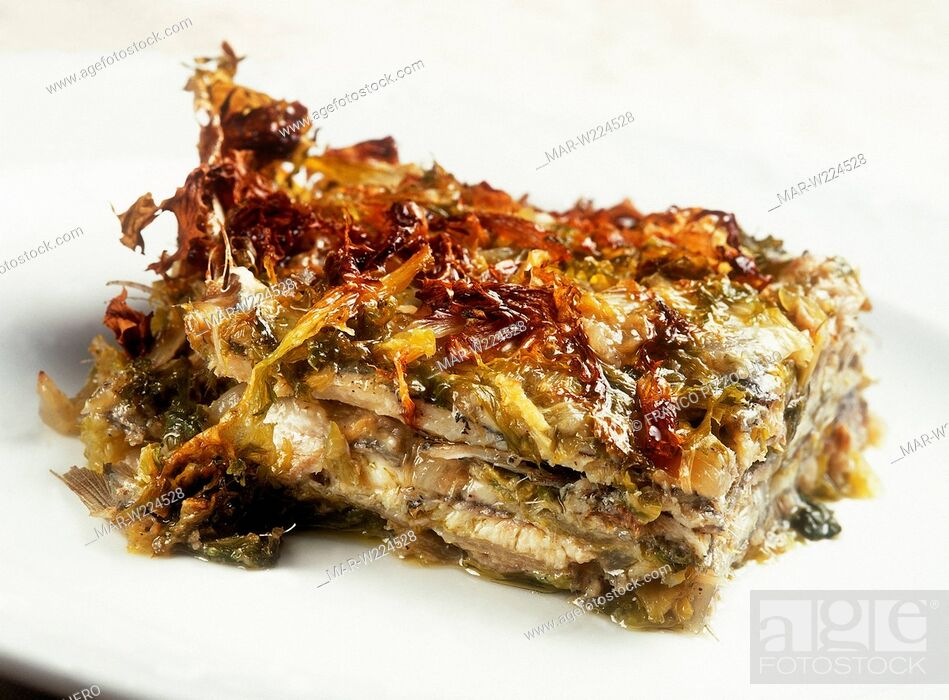 Stock Photo: pie of masculini, fresh anchovies with endive.