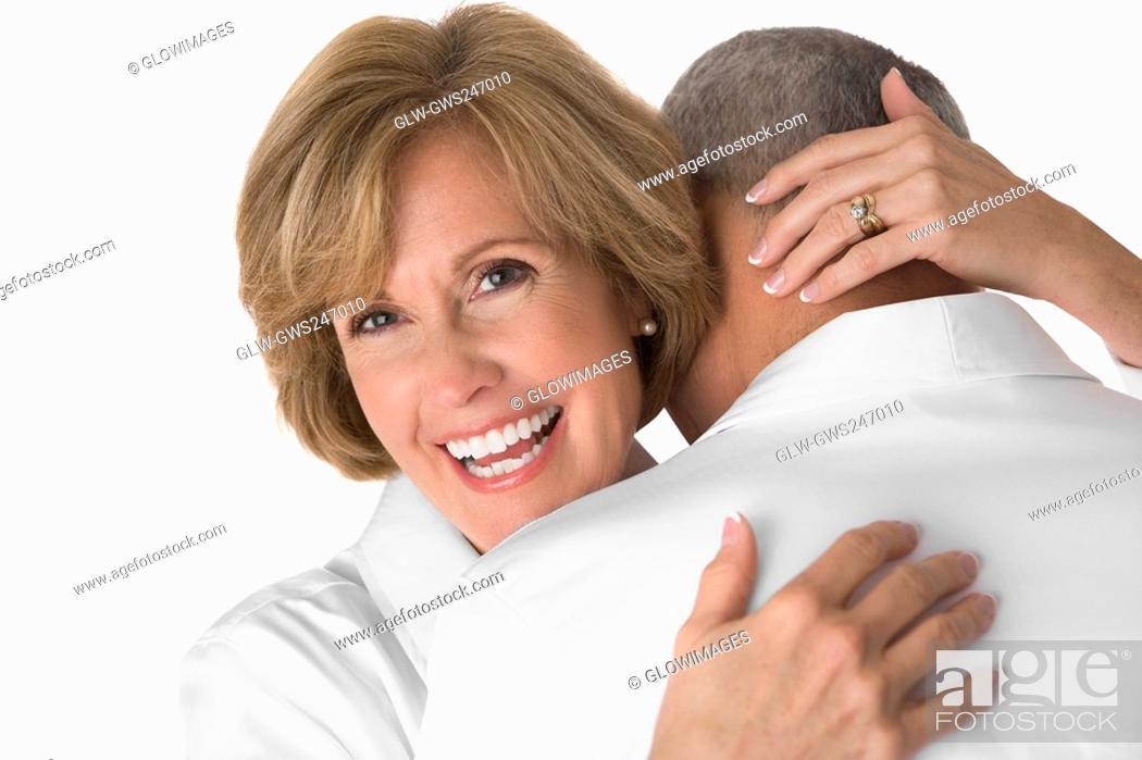 Stock Photo: Close-up of a mature woman embracing a senior man.
