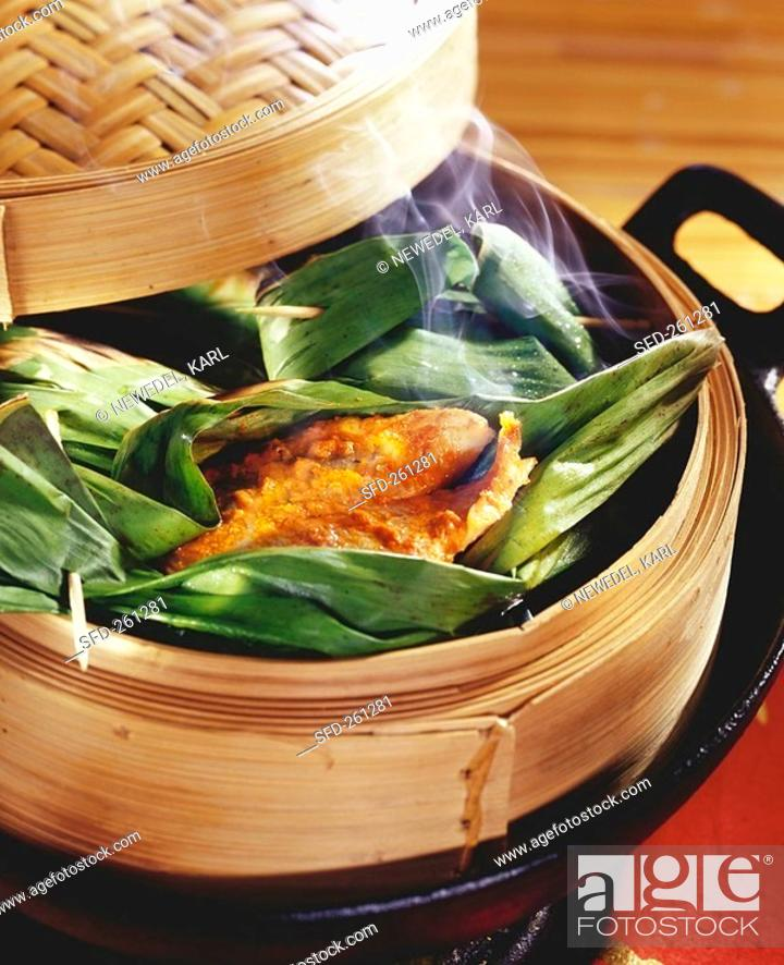 Stock Photo: Trout in banana leaf in bamboo steamer.