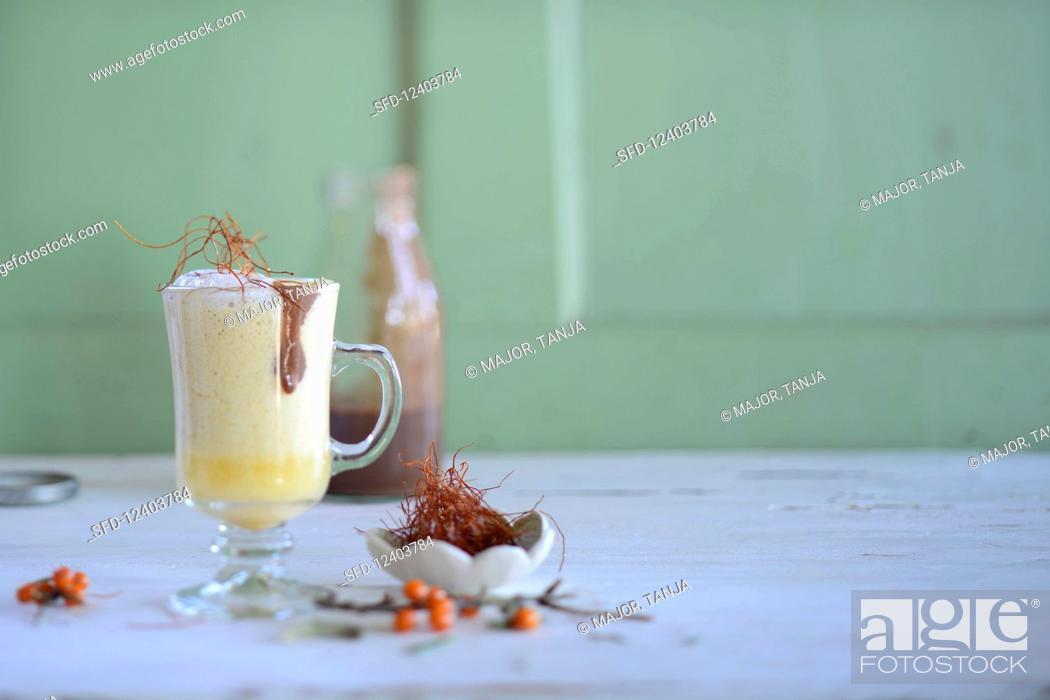 Stock Photo: Sea buckthorn milk with saffron.