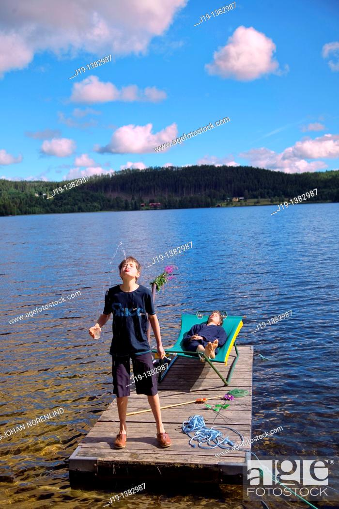 Stock Photo: Holiday at summer cottage, family and relatives North of Sweden.