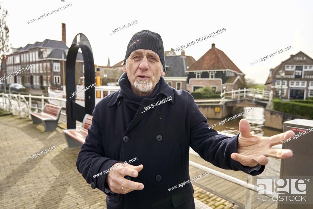 Stock Photo: senior man explaining in Ijlst, Friesland, Netherlands.