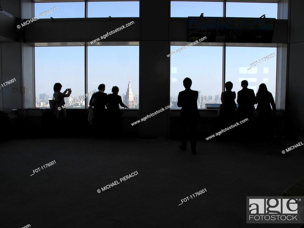 Stock Photo: Silhouette tourists view Tokyo cityscape.