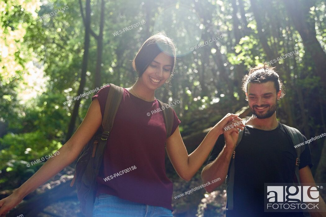 Stock Photo: Spain, Canary Islands, La Palma, smiling couple walking hand in hand through a forest.