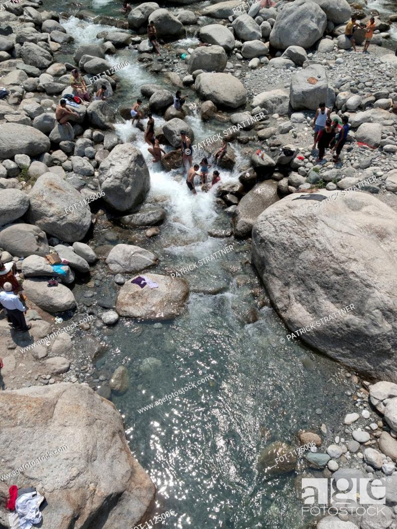Stock Photo: People bathing in a stream, India.