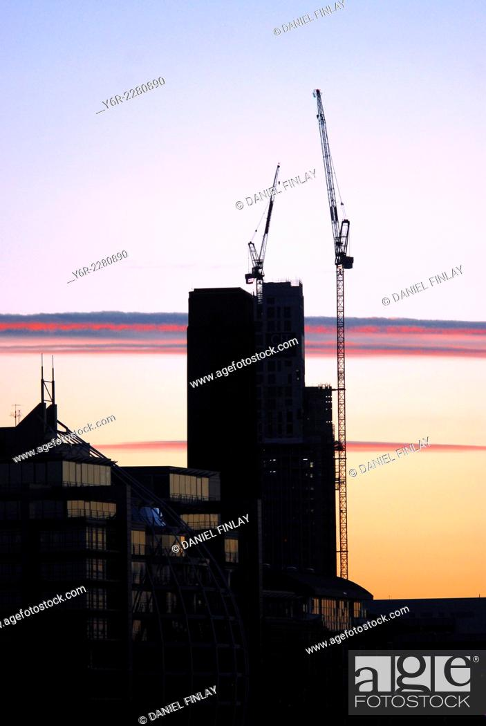 Stock Photo: Building under construction on the south bank of the River Thames in the heart of London, England, at dusk.