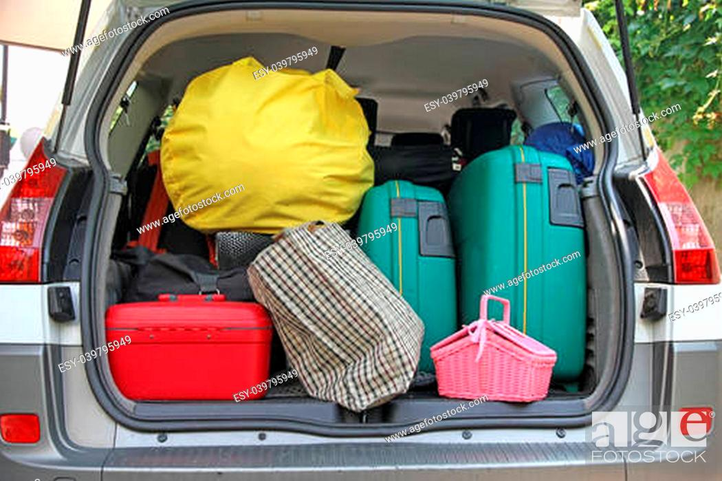 Stock Photo: two green suitcases and many bags in the trunk of the car ready to depart for the holidays.