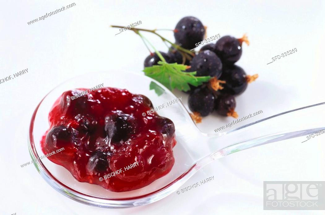 A Spoonful Of Blackcurrant Jam Stock Photo Picture And Rights