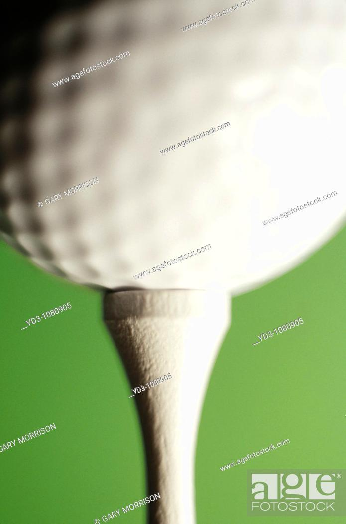 Stock Photo: Golf ball on tee, close-up.