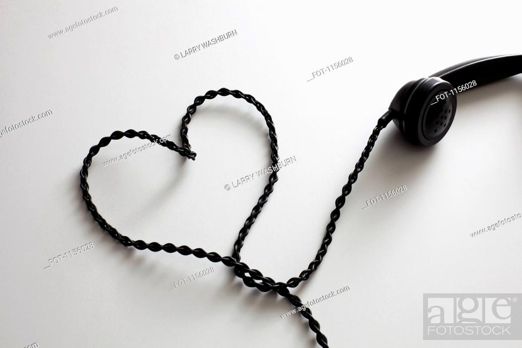 Stock Photo: An old-fashioned telephone cord arranged into the shape of a heart.