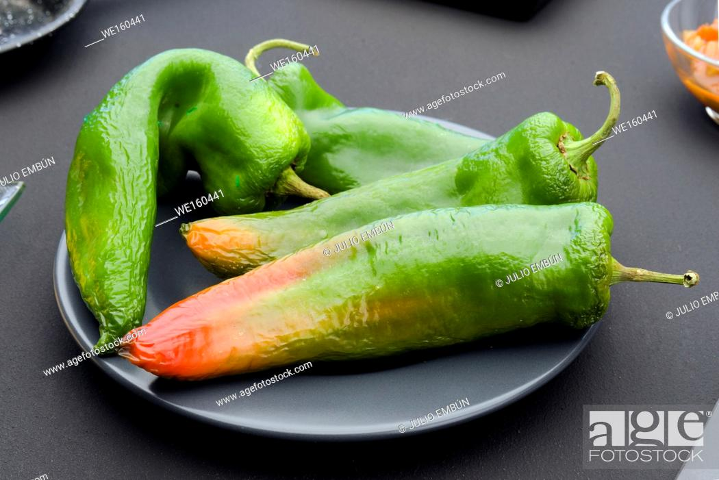 Photo de stock: green peppers on modern textured black background.