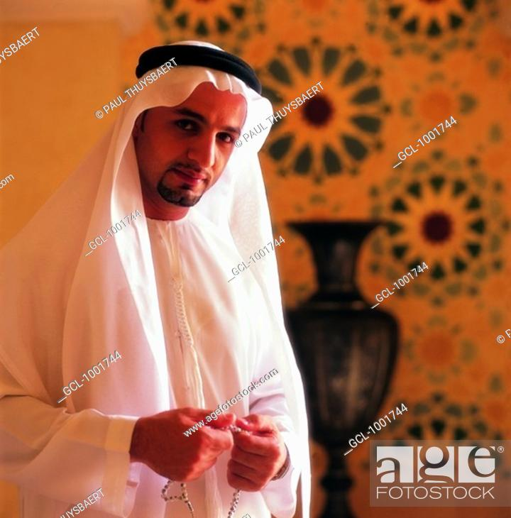 Stock Photo: Arab man with mosbah in his hands.