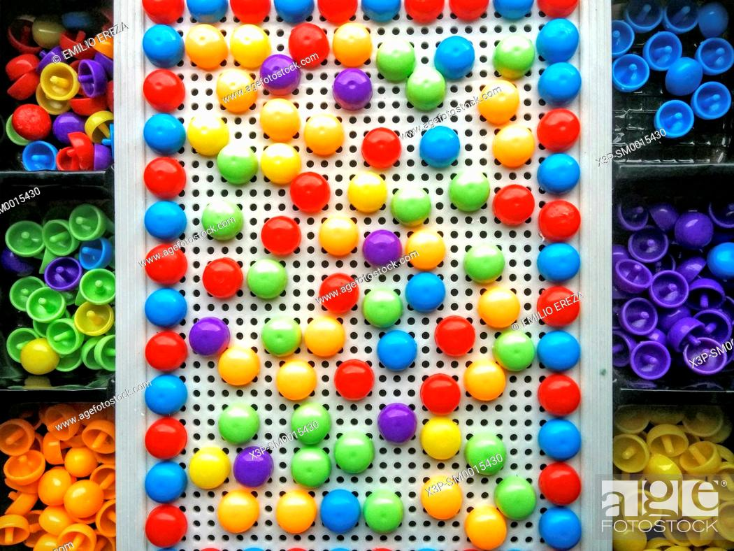 Stock Photo: Plastic dots game.