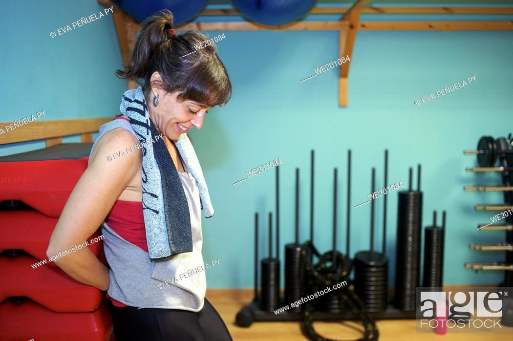 Stock Photo: Taking a break in the gym.