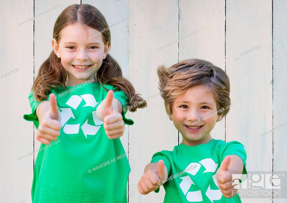 Stock Photo: Two smiling children showing thumbs up.