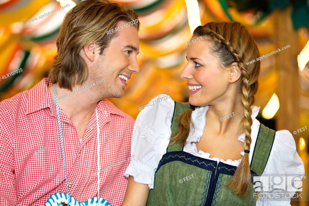 Stock Photo: Young couple in traditional Bavarian costume at the Oktoberfest, Munich, Germany.