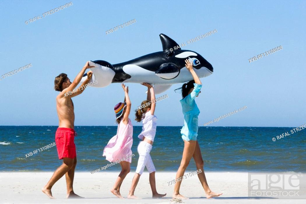 Stock Photo: happy family on beach.