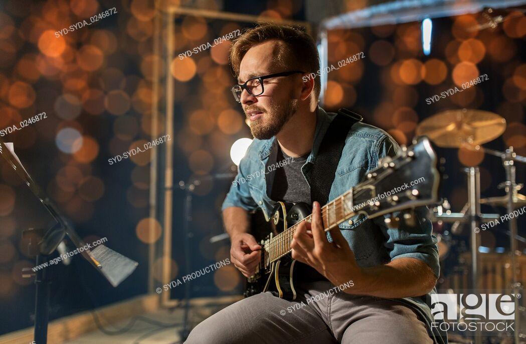 Stock Photo: man playing guitar at studio or concert.