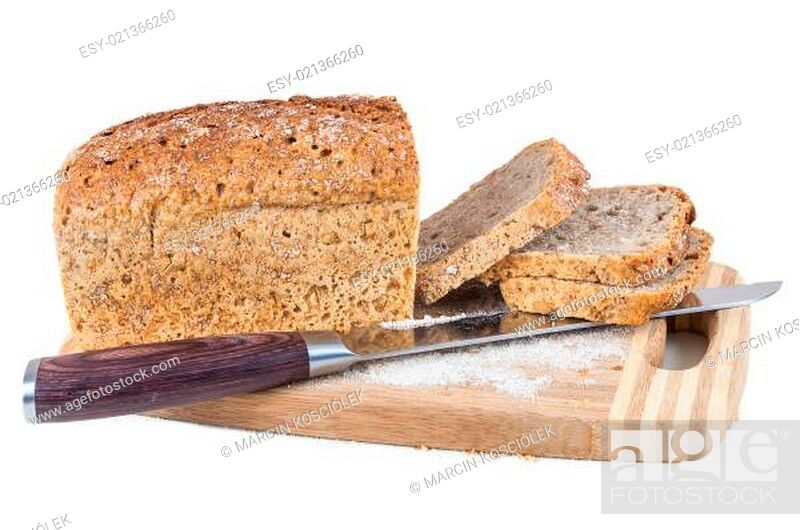 Stock Photo: Cut wholemeal bread and knife on a chopping board.