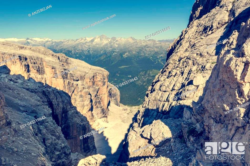 Stock Photo: Mountain view through a narrow pass. Hiking Brenta Dolomites Sentiero delle Bocchette Alte.