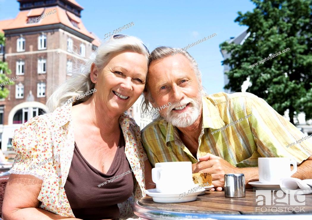 Stock Photo: Couple smiling at camera.