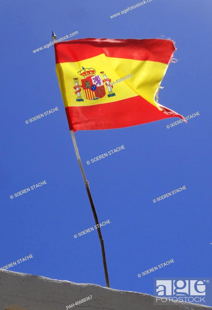 Stock Photo: The Spanish flag flies in front of a cloudless sky at the Costa Calma on Fuerteventura, Spain, 05 June 2013. Photo:Soeren Stache | usage worldwide.