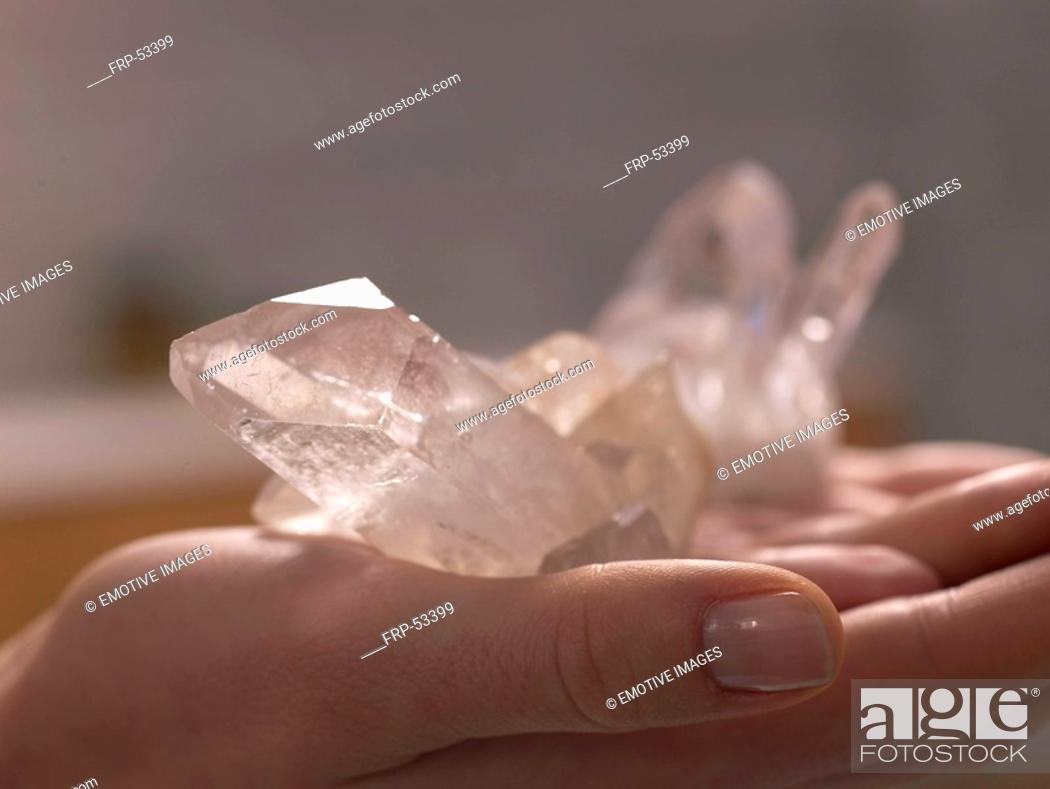 Stock Photo: Helaing stone rose quartz on a opend hand.