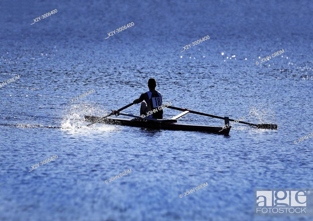 Stock Photo: Competative rower on the Charles River, Cambridge, Massachusetts, USA.