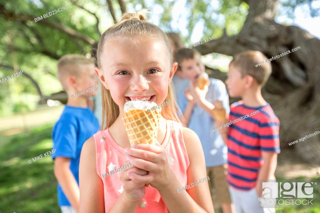 Stock Photo: Caucasian girl eating ice cream cone.