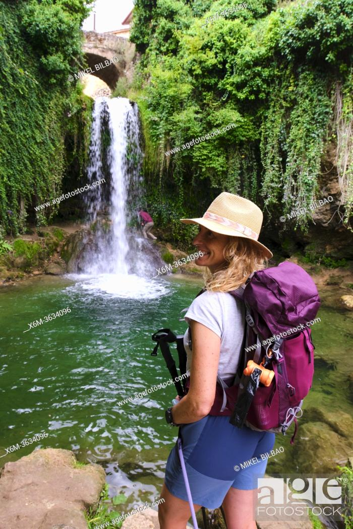 Stock Photo: Hiker mature young woman and waterfall. Tobera, Frias town, Burgos, Castile and Leon, Spain.